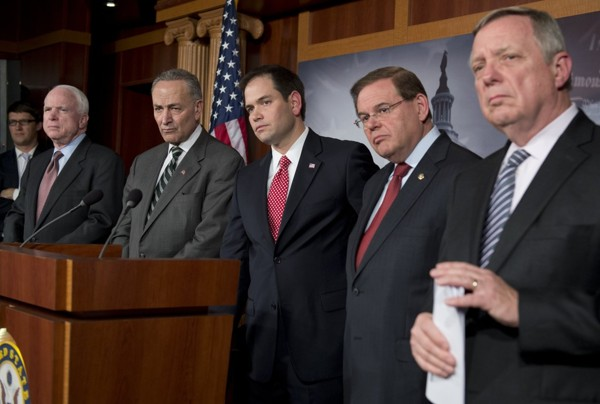 Senators participate in a news conference on immigration reform