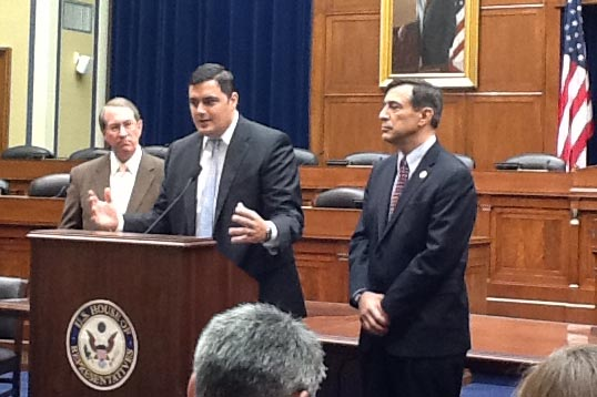 ITI's Andy Halataei speaks at the news conference to unveil the SKILLS Visa Act.